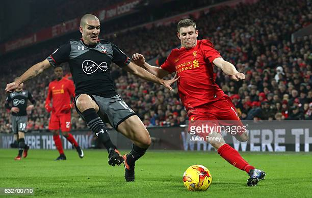 Oriol Romeu of Southampton makes a challenge on James Milner of Liverpool during the EFL Cup SemiFinal Second Leg match between Liverpool and...