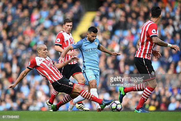 Oriol Romeu of Southampton makes a tackle on Sergio Aguero of Manchester City during the Premier League match between Manchester City and Southampton...