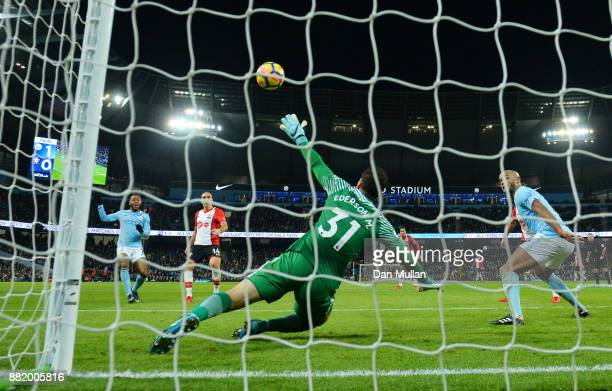 Oriol Romeu of Southampton scores his sides first goal past Ederson of Manchester City during the Premier League match between Manchester City and...