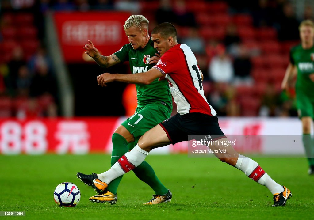 Oriol Romeu of Southampton tackles with Jonathan Schmid of FC Augsburg during the Pre-Season Friendly match between Southampton and FC Augsburg at St Mary's Stadium on August 2, 2017 in Southampton, England.