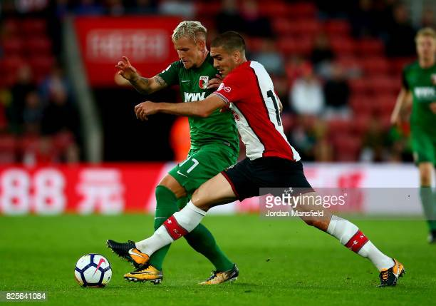 Oriol Romeu of Southampton tackles with Jonathan Schmid of FC Augsburg during the PreSeason Friendly match between Southampton and FC Augsburg at St...