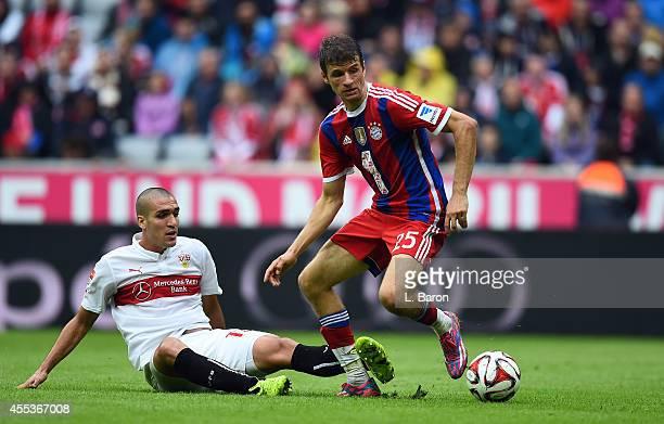 Oriol Romeu of Stuttgart challenges Thomas Mueller of Muenchen during the Bundesliga match between FC Bayern Muenchen and VfB Stuttgart at Allianz...