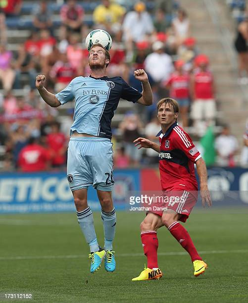 Oriol Rosell of Sporting Kansas City heads the ball over Chris Rolfe of the Chicago Fire during an MLS match at Toyota Park on July 7 2013 in...