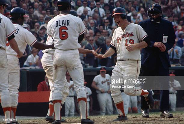 Orioles' pitcher Dave McNally is greeted by his team after scoring a home run during game 3 the 1970 World Series against the Cincinnati Reds at...