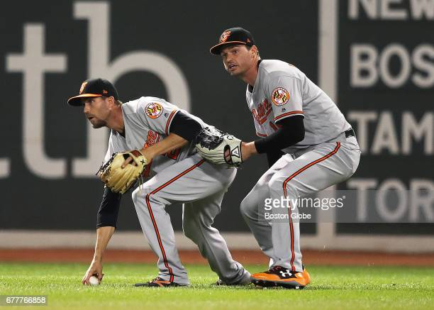 Orioles shortstop JJ Hardy left and left fielder Trey Mancini eye the base running situation after an eighth inning pop up off the bat of Red Sox...