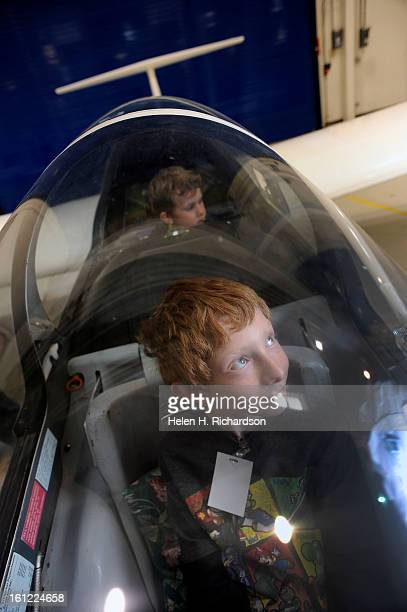 Orion Harmon in front looks delighted to be inside a Civil Air Patrol glider on display Behind him is his brother Isaac Hileman 6 Lockheed Martin...