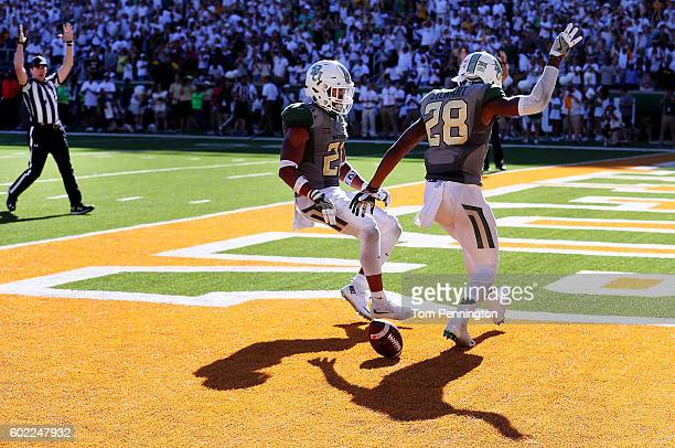 Orion Stewart of the Baylor Bears celebrates with Patrick Levels of the Baylor Bears after returning an interception for a touchdown against the...