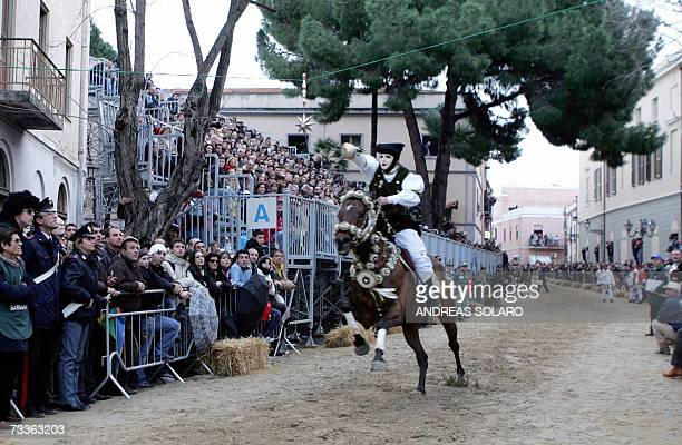 A horseman wears the mask of a mysterious God as with his foil he pierces the star during the Sartiglia carnival in Oristano Sardinia island Italy 18...