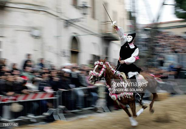 TO GO WITH STORY ' Sardinia's La Sartiglia Carnival on horseback ' The horseman wears the mask of a mysterious God and shot the point of the foil...