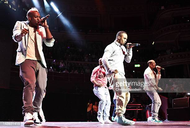 Oritse Williams Aston Merrygold JB Gill and Marvin Humes of JLS perform on stage as part of the Rays Of Sunshine concert at Royal Albert Hall on June...