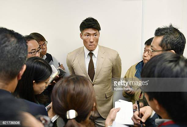 Orix Buffaloes outfielder Yoshio Itoi speaks to reporters in Osaka on Nov 7 2016 about his decision to exercise his right to domestic free agency...