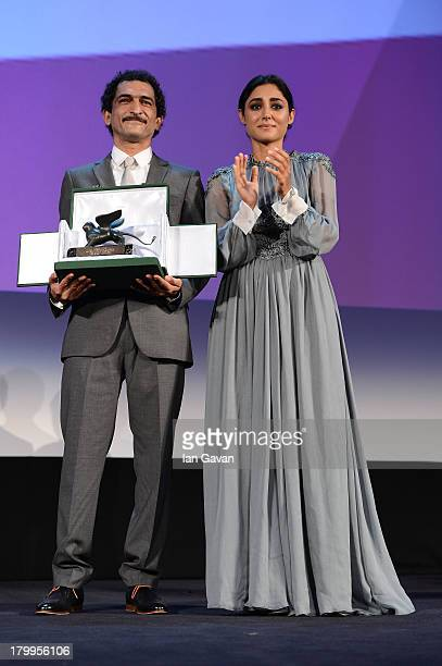 Orizzonti Jury member Iranian actress Golshifteh Farahani wears a JaegerLeCoultre Vintage Couvercle watch as she stands with Orizzonti Jury member...