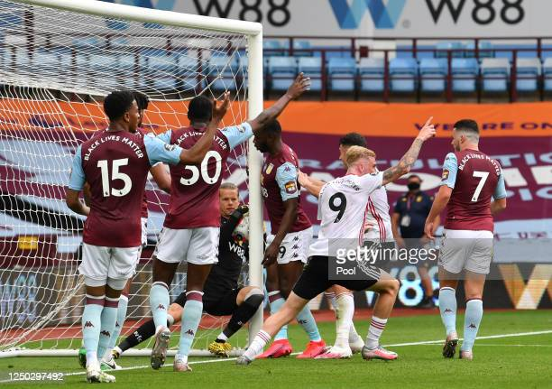 Orjan Nyland of Aston Villa catches the ball as players react to the referee during the Premier League match between Aston Villa and Sheffield United...