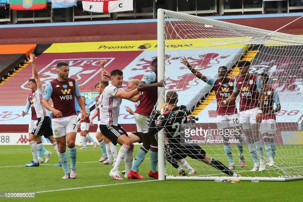 Orjan Nyland of Aston Villa fumbles and pulls the ball from being the line but Referee Michael Oliver calls a no goal as the goal line technology...