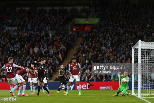 Orjan Nyland of Aston Villa saves a headed effort from John Stones of Manchester City during the Carabao Cup Final match between Aston Villa and...
