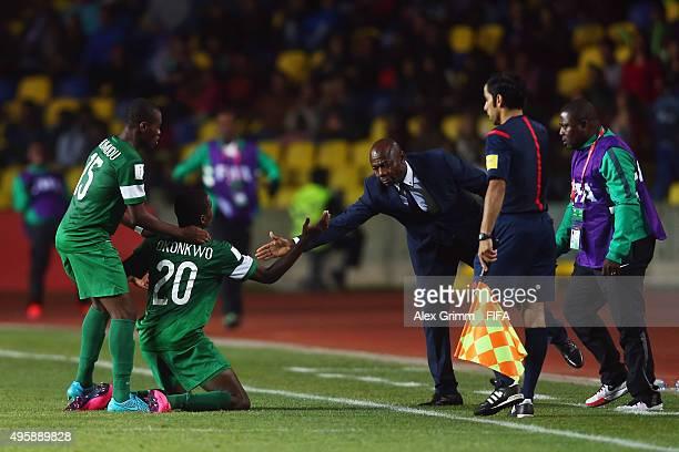 Orji Okwonkwo of Nigeria celebrates his team's second goal with head coach Emmanuel Amuneke during the FIFA U-17 World Cup Chile 2015 Semi Final...