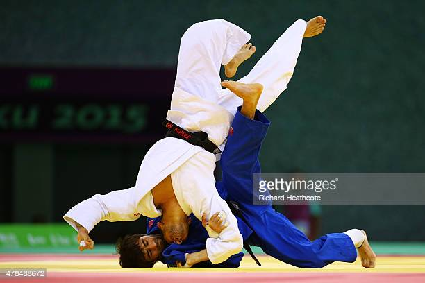 Orkhan Safarov of Azerbaijan and Beslan Mudranov of Russia compete in the Men's -60kg gold medal bout on day thirteen of the Baku 2015 European Games...