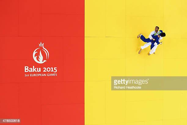 Orkhan Safarov of Azerbaijan and Beslan Mudranov of Russia compete in the Men's 60kg gold medal bout during day thirteen of the Baku 2015 European...