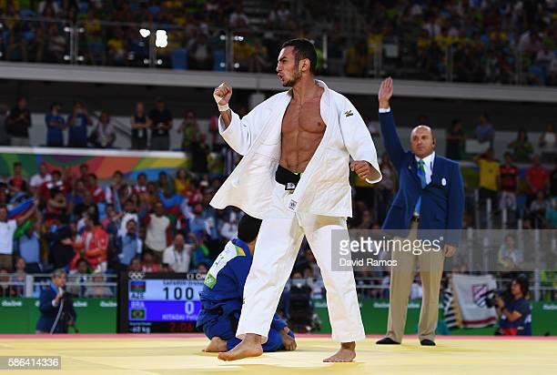 Orkhan Safarov of Azerbaijan celebrates after defeating Felipe Kitadai of Brazil in the Men's -60 kg Judo on Day 1 of the Rio 2016 Olympic Games at...