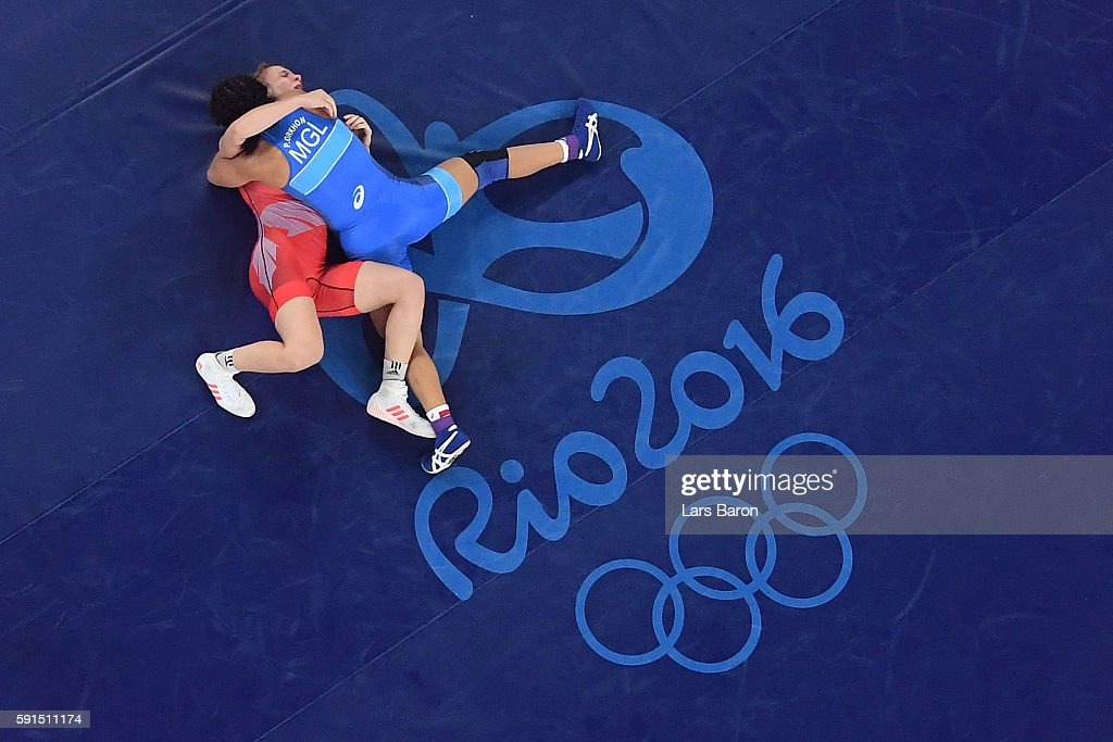 Orkhon Purevdorj (R) of Mongolia competes against Luisa Helga Gerda Niemesch of Germany during a Women's Freestyle 58kg Repechage Round 1 bout on Day 12 of the Rio 2016 Olympic Games at Caioca Arena 2 on August 17, 2016 in Rio de Janeiro, Brazil.