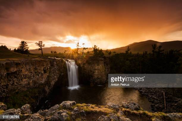orkhon waterfall at sunset in mongolia - anton petrus stock pictures, royalty-free photos & images