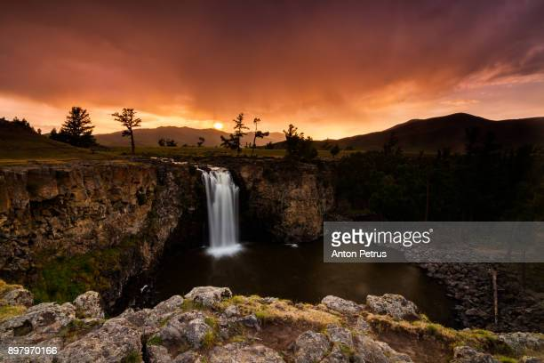 orkhon waterfall in mongolia at sunset. mongolia - anton petrus stock pictures, royalty-free photos & images