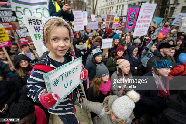 Orla Dean holds a placard during the Time's Up rally at Richmond Terrace opposite Downing Street on January 21 2018 in London England The Time's Up...