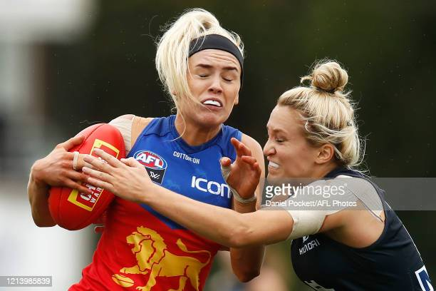 Orla O'Dwyer of the Lions is tackled by Jess Hosking of the Blues during the AFLW Semi Final match between the Carlton Blues and the Brisbane Lions...