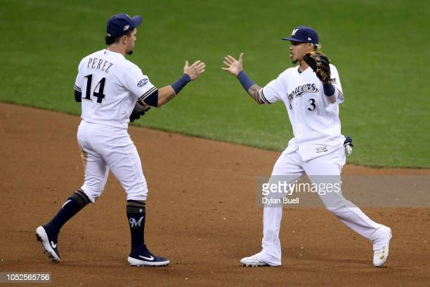 Orlando Arcia and Hernan Perez of the Milwaukee Brewers celebrate after defeating the Los Angeles Dodgers in Game Six of the National League...