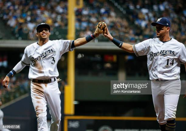 Orlando Arcia and Hernan Perez of the Milwaukee Brewers high five after an inning ending double play during the fifth inning at Miller Park on...