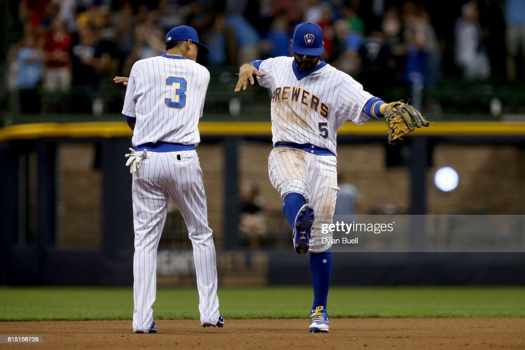 Orlando Arcia #3 and Jonathan Villar #5 of the Milwaukee Brewers celebrate after beating the Philadelphia Phillies 3-2 at Miller Park on July 15, 2017 in Milwaukee, Wisconsin.