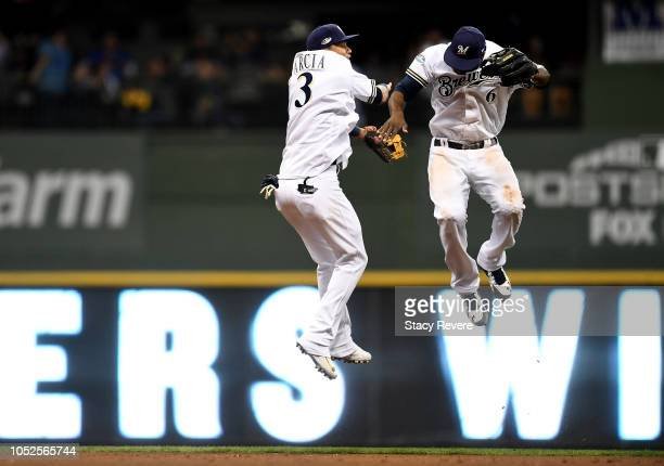 Orlando Arcia and Lorenzo Cain of the Milwaukee Brewers celebrate after defeating the Los Angeles Dodgers in Game Six of the National League...