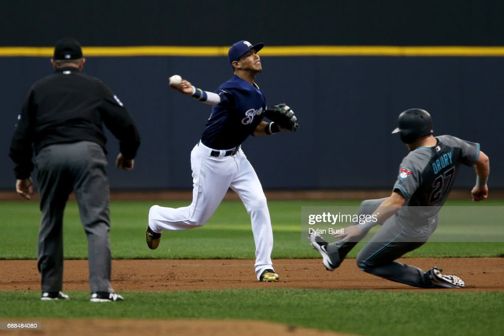 Orlando Arcia #3 of the Milwaukee Brewers attempts to turn a double play past Brandon Drury #27 of the Arizona Diamondbacks in the second inning at Miller Park on May 25, 2017 in Milwaukee, Wisconsin.
