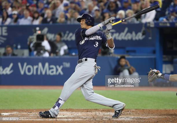 Orlando Arcia of the Milwaukee Brewers bats in the fourth inning during MLB game action against the Toronto Blue Jays at Rogers Centre on April 11...