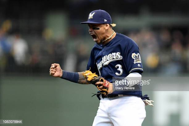 Orlando Arcia of the Milwaukee Brewers celebrates a double play to close out the seventh inning against the Los Angeles Dodgers in Game Two of the...