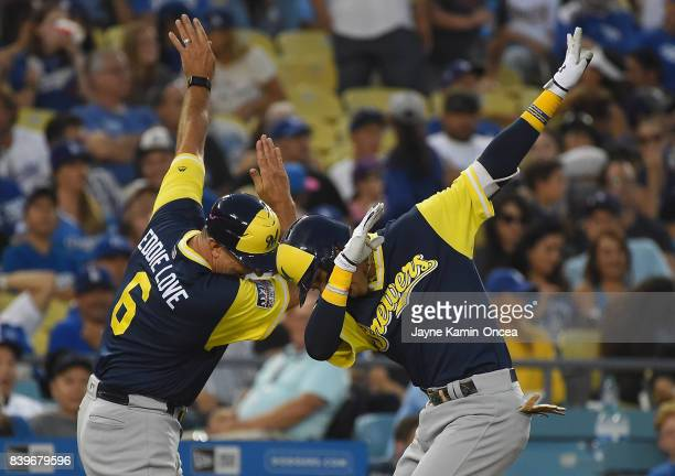 Orlando Arcia of the Milwaukee Brewers celebrates a two run home run with third base coach Ed Sedar of the Milwaukee Brewers in the fifth inning of...