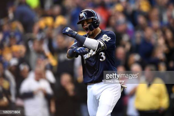 Orlando Arcia of the Milwaukee Brewers celebrates after hitting a solo home run against HyunJin Ryu of the Los Angeles Dodgers during the fifth...