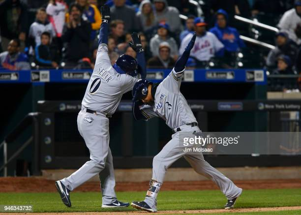 Orlando Arcia of the Milwaukee Brewers celebrates his ninth inning home run against the New York Mets with third base coach Ed Sedar at Citi Field on...