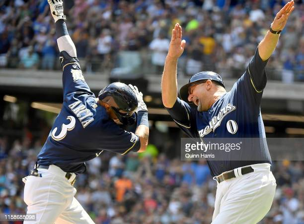 Orlando Arcia of the Milwaukee Brewers celebrates with Ed Sedar of the Milwaukee Brewers after his three run home run in the fourth inning against...