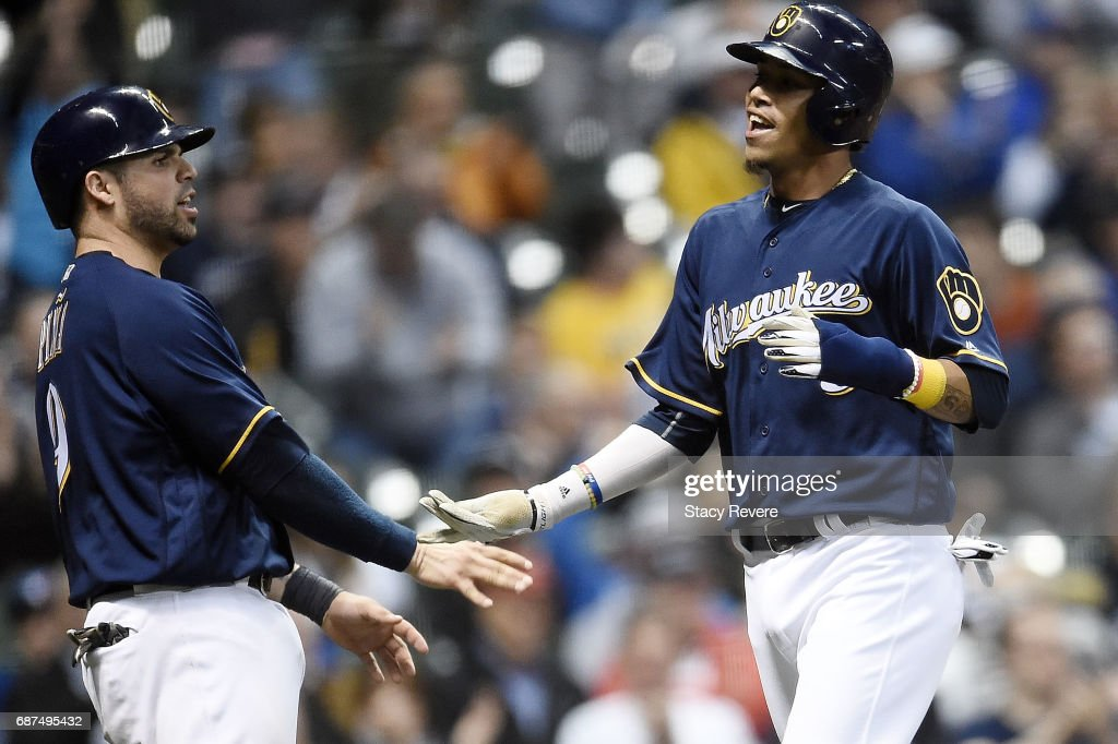 Orlando Arcia #3 of the Milwaukee Brewers celebrates with Manny Pina #9 after scoring a run during the fifth inning of a game against the Toronto Blue Jays at Miller Park on May 23, 2017 in Milwaukee, Wisconsin.