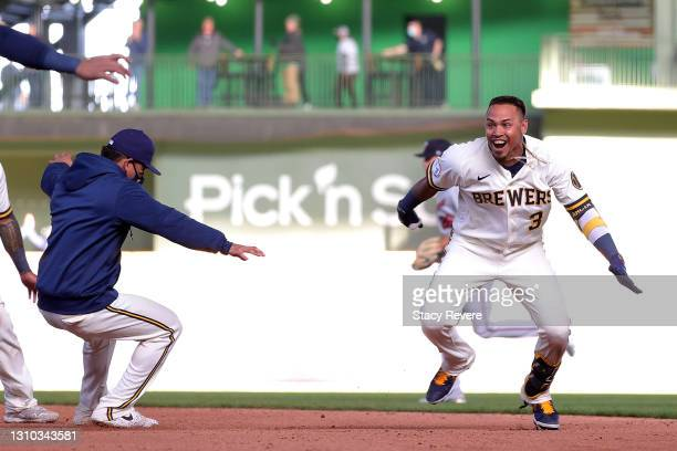 Orlando Arcia of the Milwaukee Brewers celebrates with teammates after driving in the game winning run during the tenth inning against the Minnesota...