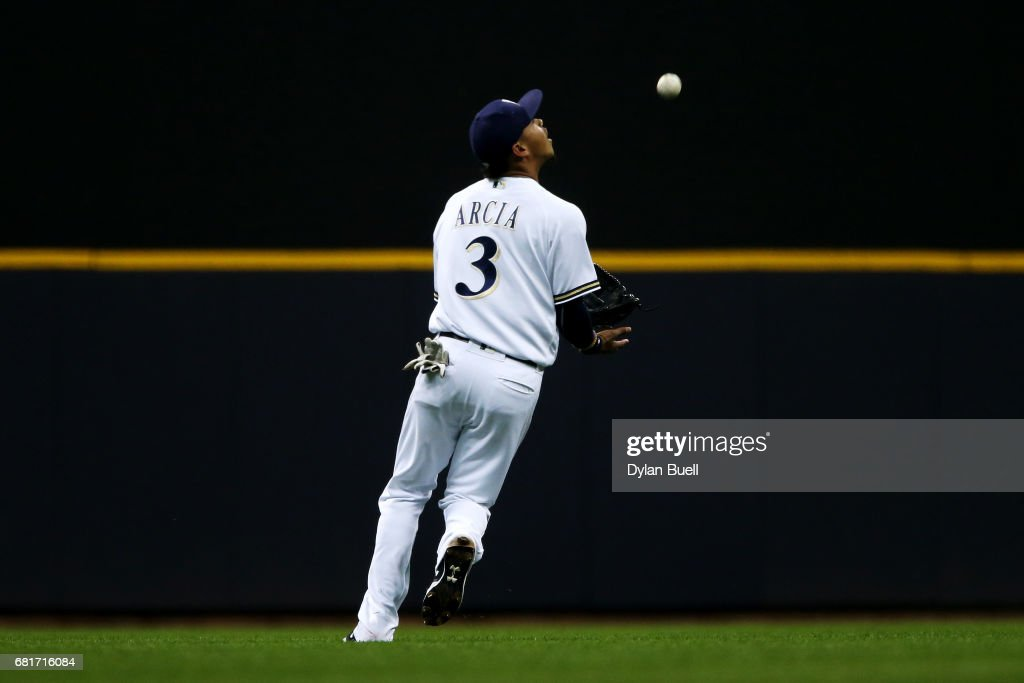 Orlando Arcia #3 of the Milwaukee Brewers chases down a fly ball for the out\ in the second inning against the Boston Red Sox at Miller Park on May 10, 2017 in Milwaukee, Wisconsin.