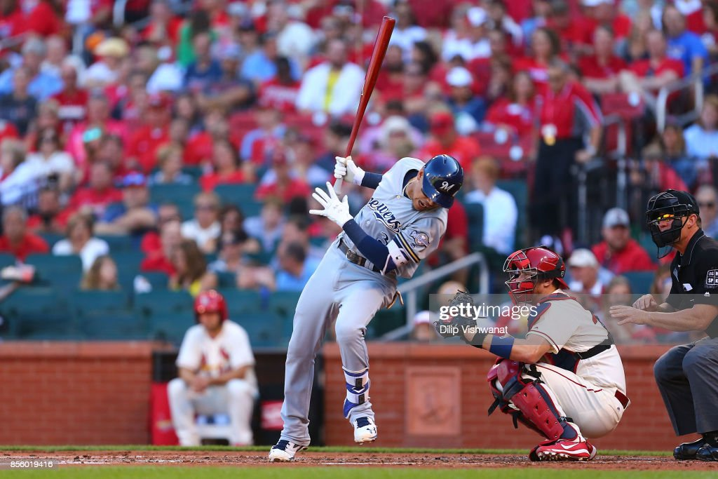 Orlando Arcia #3 of the Milwaukee Brewers dodges an inside pitch against the St. Louis Cardinals in the second inning at Busch Stadium on September 30, 2017 in St. Louis, Missouri.