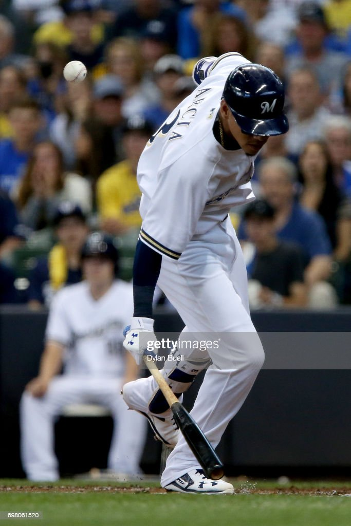 Orlando Arcia #3 of the Milwaukee Brewers ducks to avoid being hit by a pitch in the second inning against the Pittsburgh Pirates at Miller Park on June 19, 2017 in Milwaukee, Wisconsin.