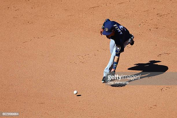 Orlando Arcia of the Milwaukee Brewers fields a ground ball against the St Louis Cardinals in the fifth inning at Busch Stadium on September 11 2016...