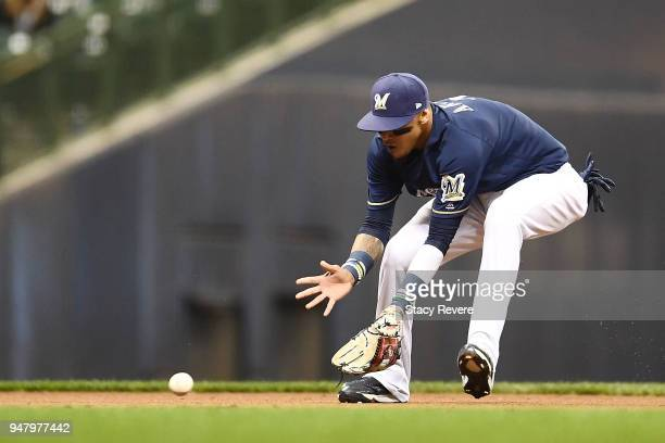 Orlando Arcia of the Milwaukee Brewers fields a ground ball during a game against the Cincinnati Reds at Miller Park on April 16 2018 in Milwaukee...