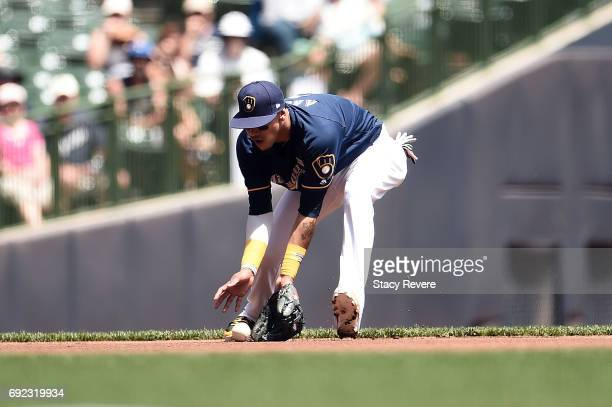Orlando Arcia of the Milwaukee Brewers fields a ground ball during the first inning of a game against the Los Angeles Dodgers at Miller Park on June...