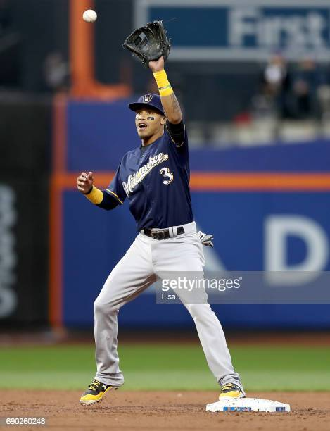 Orlando Arcia of the Milwaukee Brewers fields a hit by Lucas Duda of the New York Mets and gets the force out at second but is unable to turn the...