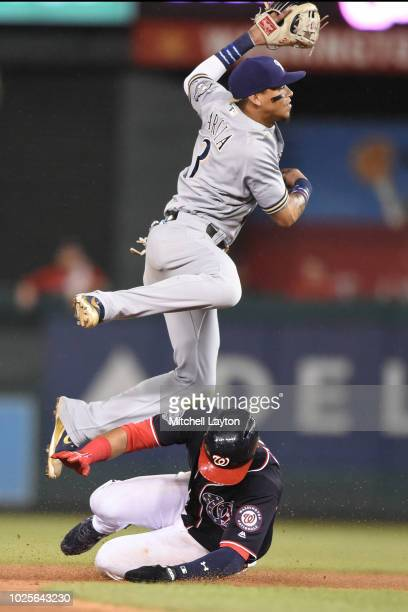 Orlando Arcia of the Milwaukee Brewers forces out Juan Soto of the Washington Nationals on a Ryan Zimmerman double play in the eighth inning during a...