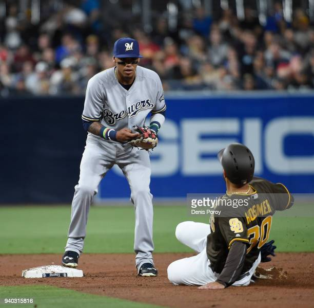 Orlando Arcia of the Milwaukee Brewers gets the force out at second base on Eric Hosmer of the San Diego Padres but forgets to throw to first base...